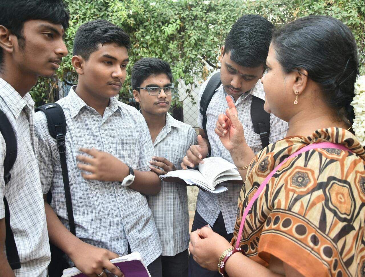 Boys take some last minute tips from their teacher in Chennai. (Ashwin Prasath | EPS)