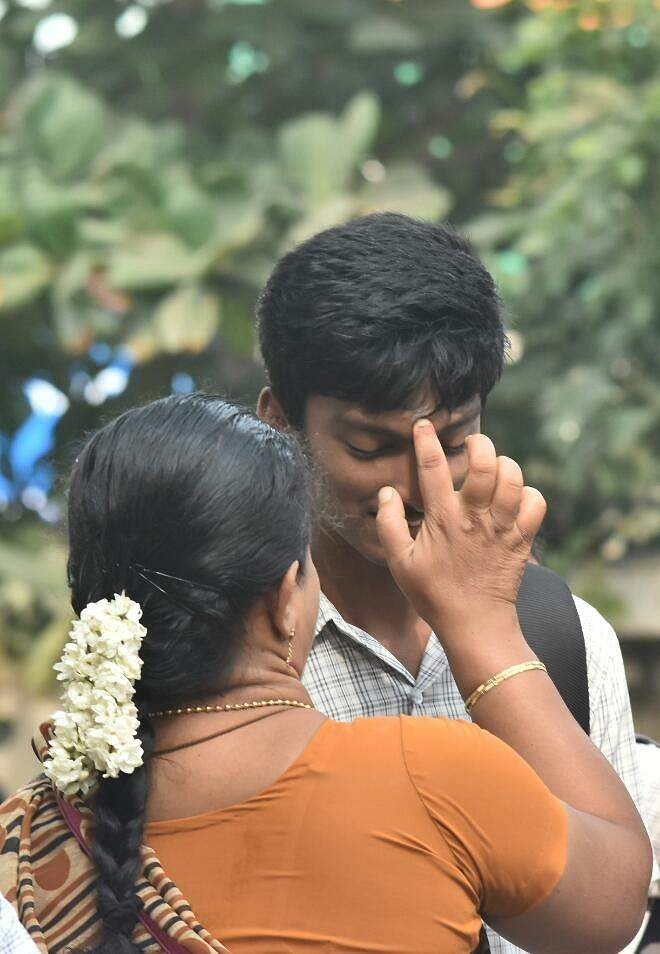 A student appearing for the board exams takes his mother's blessings before entering the exam hall in Chennai. (Ashwin Prasath | EPS)
