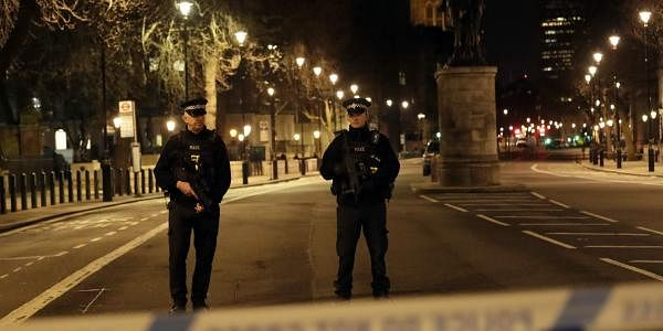 Two policemen stand guard at a cordoned off area on the way to the Houses of Parliament in central London. (Photo | AP)