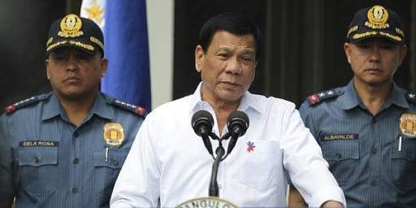 Philippine President Rodrigo Duterte, center, speaks to erring policemen during an audience at the Presidential Palace grounds in Manila, Philippines (File Photo | AP)