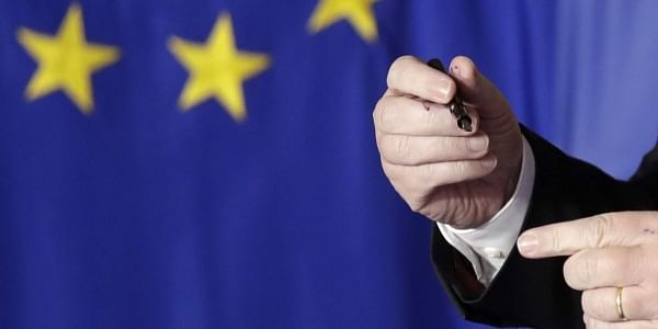 European Commission President Jean-Claude Juncker gets ink on his hands as he signs a declaration (Photo | AP)