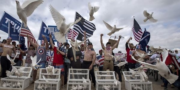 President Donald Trump supporters release doves during a march, in Huntington Beach, Calif., on Saturday, March 25, 2017. (Photo | AP)