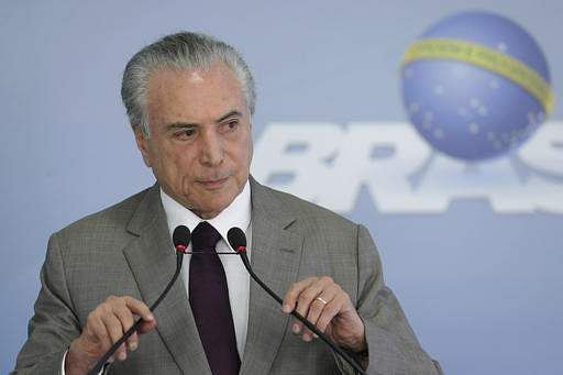 Brazil's President Michel Temer adjusts his microphones during a press conference at the Planalto Presidential Palace, in Brasilia, Brazil, Monday, Feb. 13, 2017, where he spoke on the security vacuum created by a 'police halt' in the Brazilian state Espirito Santo.(Photo | AP)