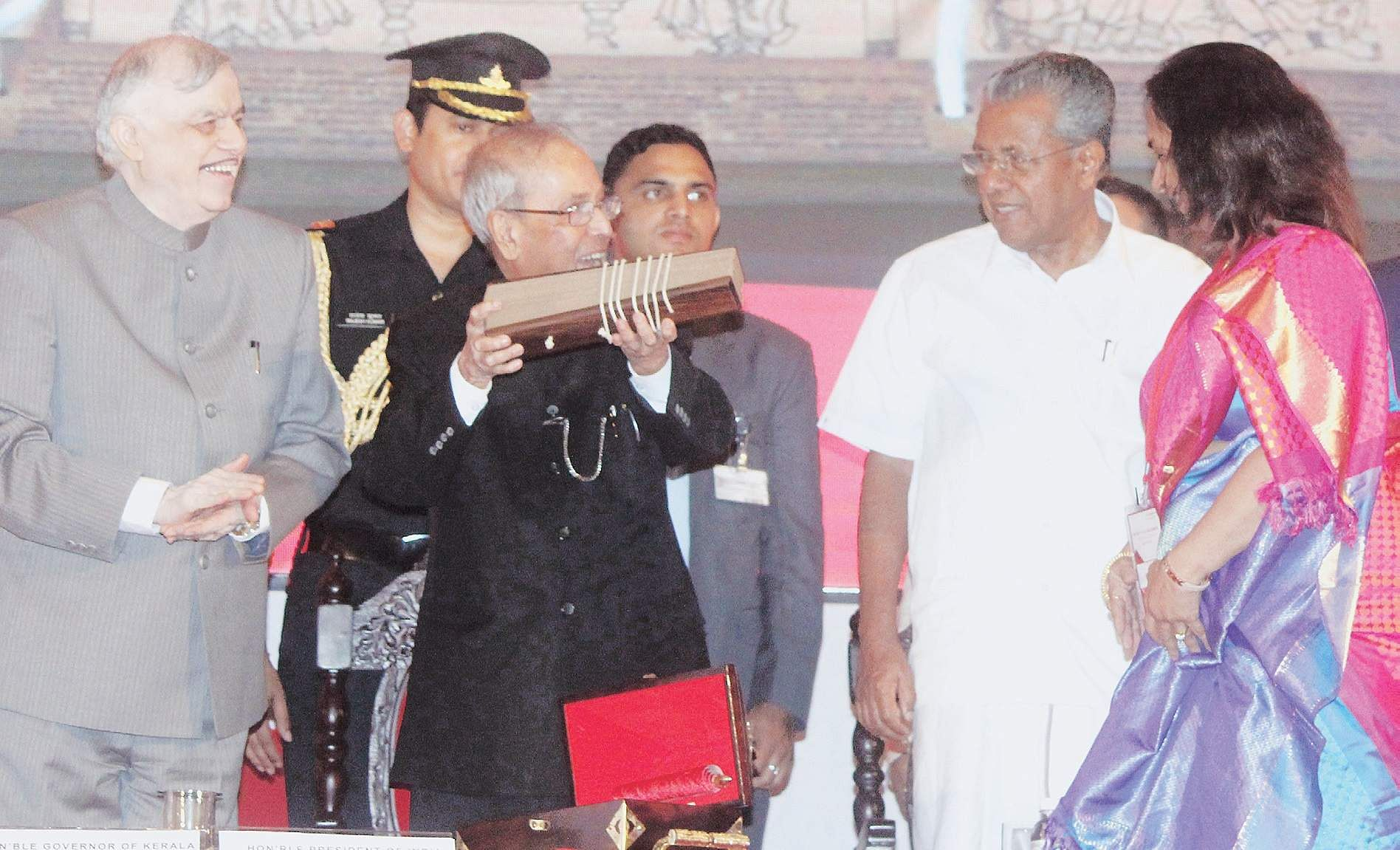 President Pranab Mukharjee receiving the Adhyatma Ramayanam on palm leaves after delivering the sixth K S Rajamony memorial lecture in Kochi on Thursday. Governor P Sathasivam, Chief Minister Pinarayi Vijayan and daughter of K S Rajamony Leela Ganesh are also seen | Melton Antony