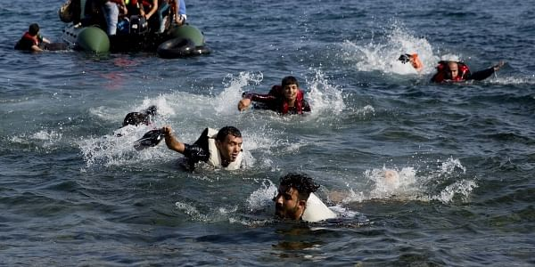 Migrants whose boat stalled at sea while crossing from Turkey to Greece swim to approach the shore of the island of Lesbos, Greece. (File | AP)