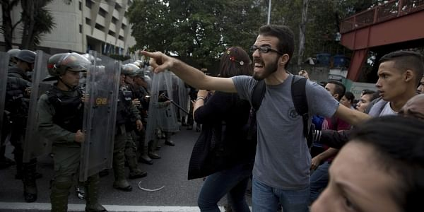 A university student shouts at a line of Venezuelan National Guard officers in riot gear during a protest outside of the Supreme Court in Caracas, Venezuela, Friday, March 31, 2017. (Photo | AP)
