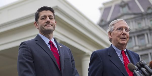 House Speaker Paul Ryan of Wis. listens at left as Senate Majority Leader Mitch McConnell of Ky. speaks to reporters outside the White House in Washington (File Photo | AP)