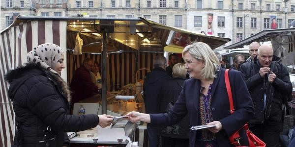 French far-right leader Marine Le Pen hands out leaflets in a marketplace, in Arras northern France, as part of her municipal campaign. (File Photo | AP)
