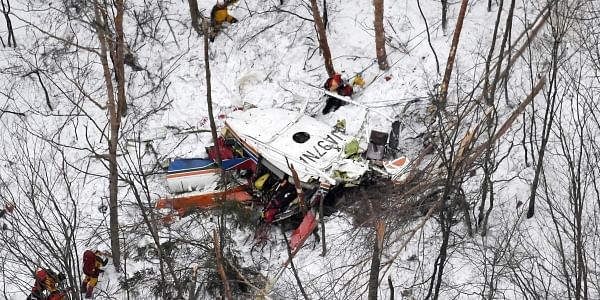 Rescuers work near the helicopter crashed in mountains in Nagano prefecture, central Japan Sunday, March 5, 2017. (Photo | AP)
