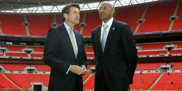 Namibian former athlete Frank Fredericks, right, as he takes a look on the Wembley Pitch with Sebastian Coe during a visit by the International Olympic Committee to Wembley Stadium in London. (File photo | AP)