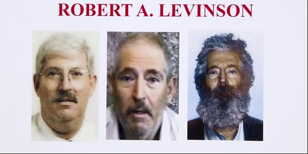 An FBI poster showing a composite image of former FBI agent Robert Levinson, right, of how he would look like now after five years in captivity (File Photo | AP)