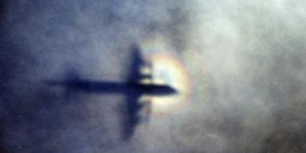 Shadow of a Royal New Zealand Air Force P3 Orion is seen on low level cloud while the aircraft searches for missing Malaysia Airlines Flight MH370 in the southern Indian Ocean (Photo | AP)