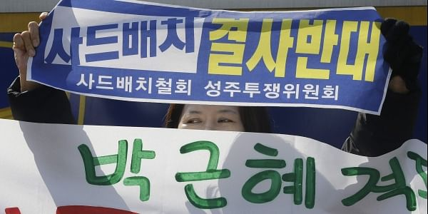 A protester holds up a banner during a rally to oppose the plan to deploy the Terminal High-Altitude Area Defense system, or THAAD, in front of the Defense Ministry in Seoul. (Photo | AP)