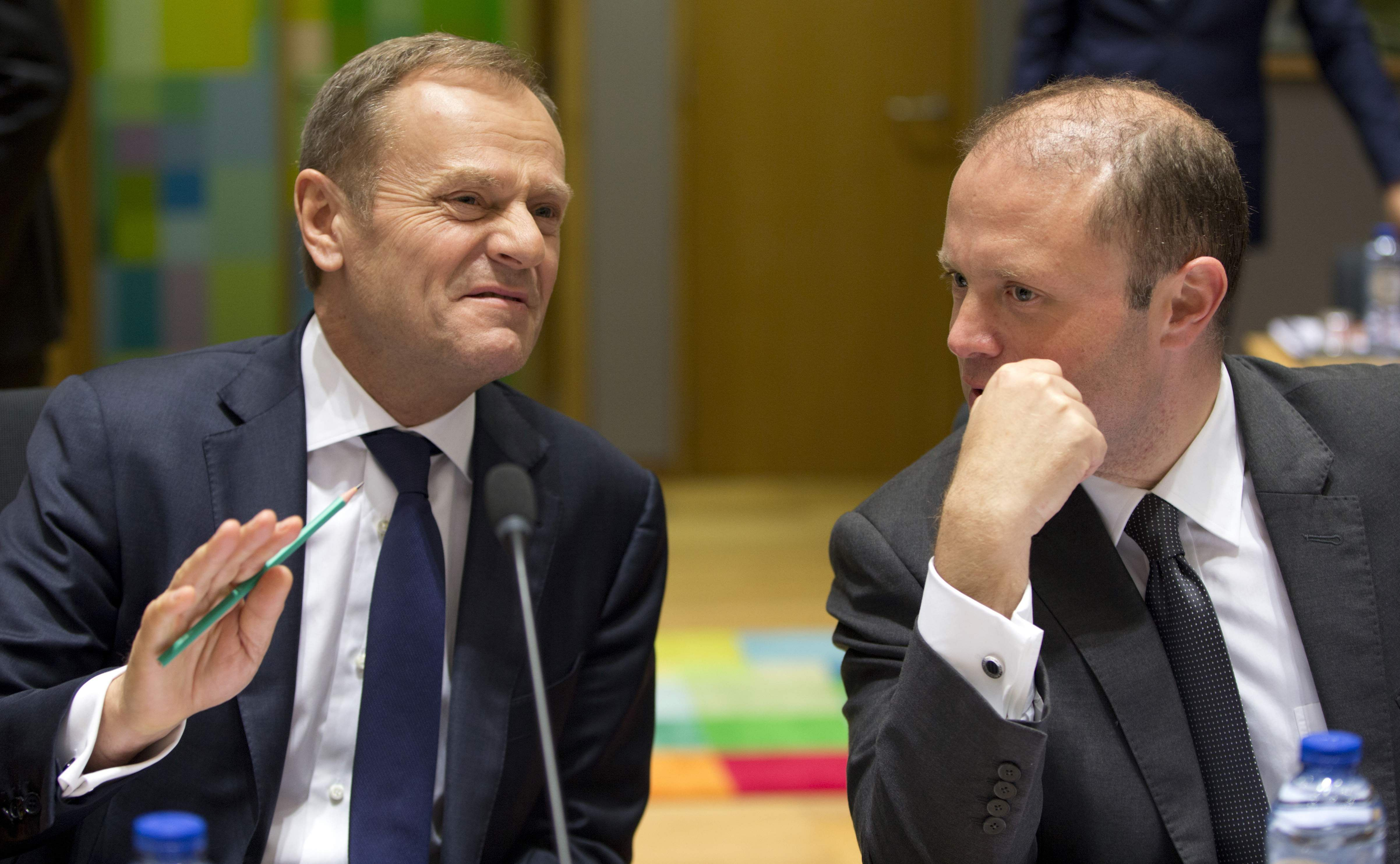 donald tusk gets second term for top eu job despite polish european council president donald tusk left speaks s prime minister joseph muscat as they wait for the start of a pre eu summit tripartite