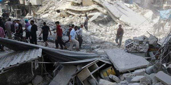 People inspect the damage at a market hit by airstrikes in Aleppo. (File photo| Reuters)