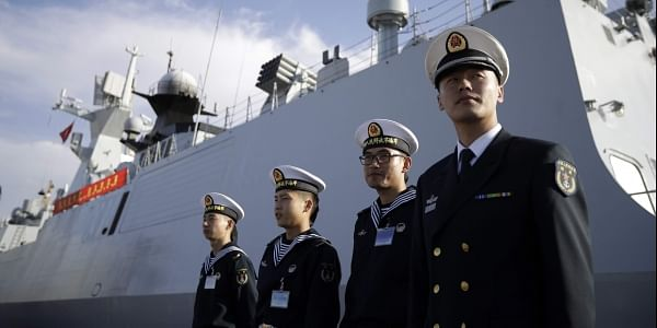 Chinese Navy officials stand in front of the ship Daqing during a visit in San Diego. (File Photo | AP)