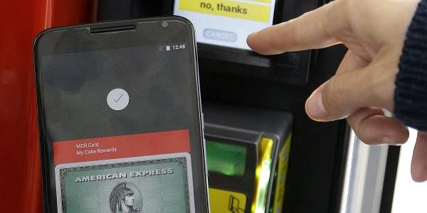 A Google employee gives a demonstration of Android Pay on a phone at Google I/O 2015 in San Francisco.(File Photo | AP)
