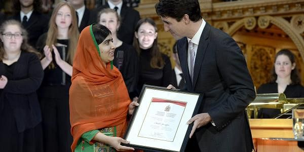 Pakistani activist and Nobel Peace Prize winner Malala Yousafzai, left, is presented with an honorary Canadian citizenship by Prime Minister Justin Trudeau in on Parliament Hill in Ottawa on April 12, 2017. (Photo   AP)