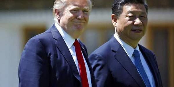 President Donald Trump and Chinese President Xi Jinping walk together after their meetings at Mar-a-Lago on April 7, 2017. (File photo | AP)