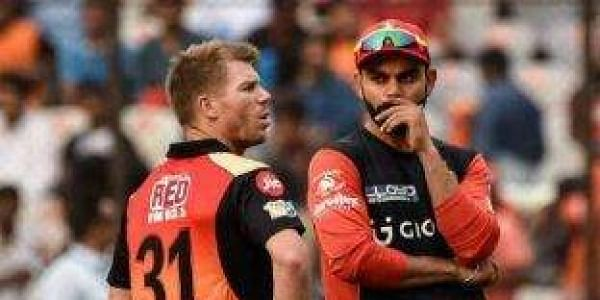 David Warner (L) and Virat Kohli | EPS