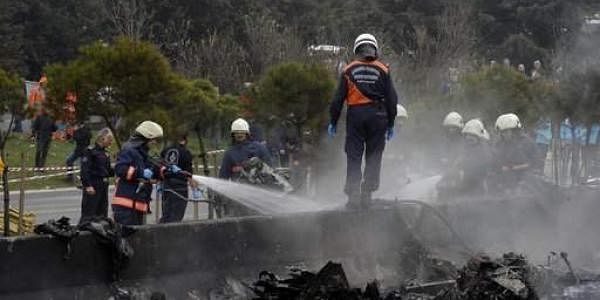 Firefighters work on the site shortly after a helicopter with seven people inside crashed in Istanbul. (Photo   AP)
