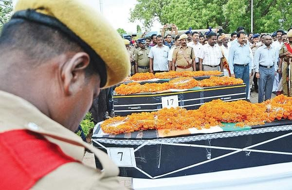 Cops paying homage to the mortal remains of the three CRPF soldiers at the Tiruchy airport on Tuesday | M K Ashok Kumar