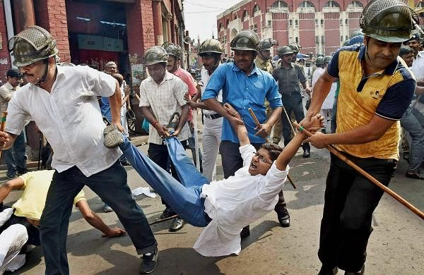 Police detain a Congress activist during a protest against TMC leaders involved in the Narada scam, in Kolkata on Thursday (File | PTI)