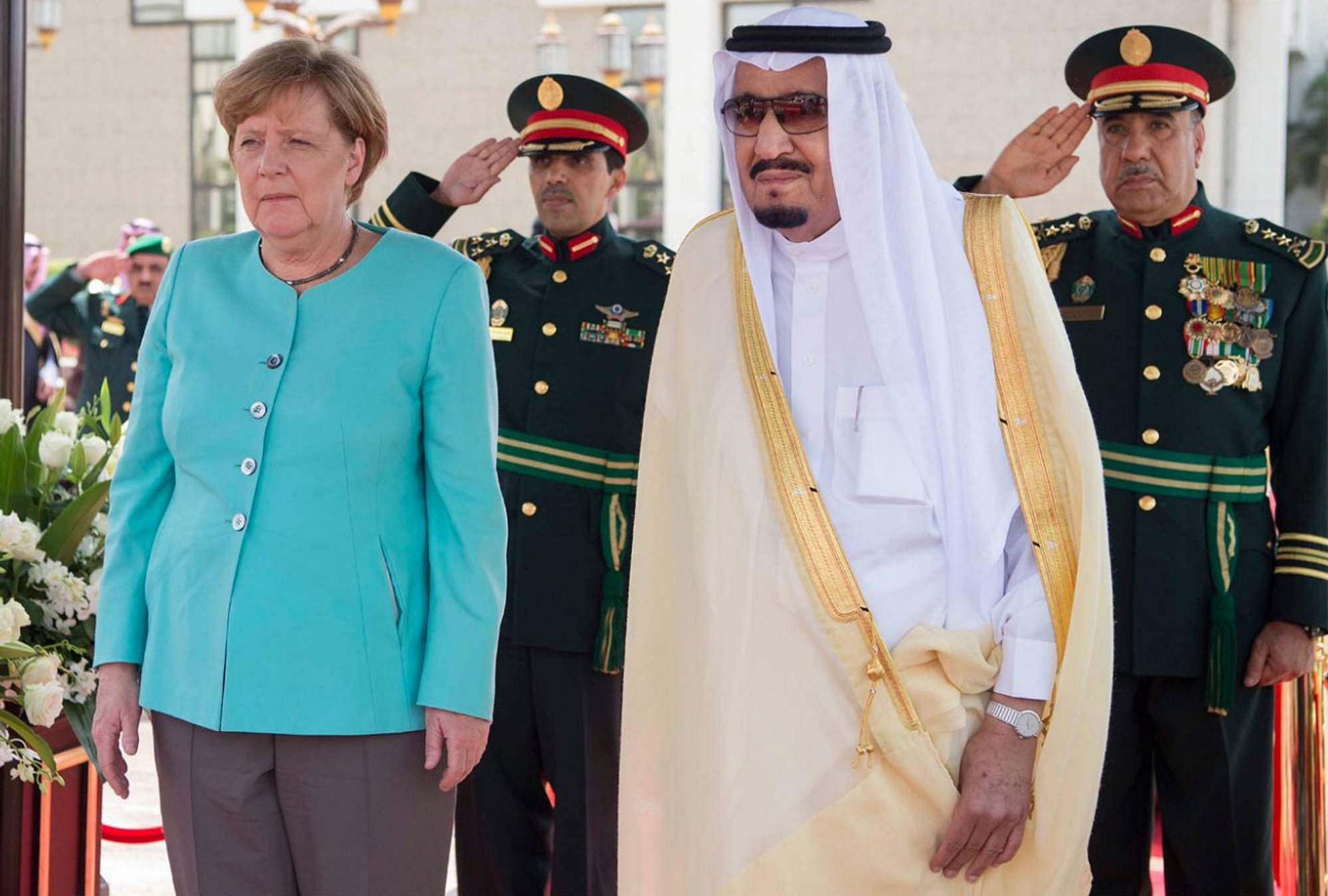 Germany's Merkel presses Saudi Arabia on refugees and rights