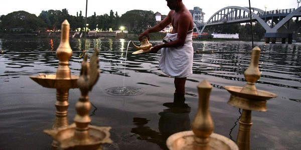 A priest cleans 'kuthuvilakku' before the Shivaratri celebrations in Aluva Manappuram. (Albin Mathew  EPS)