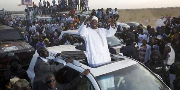 Gambian President Adama Barrow, waves as he rides his motorcade through crowds of hundreds of thousands. (File photo | AP)