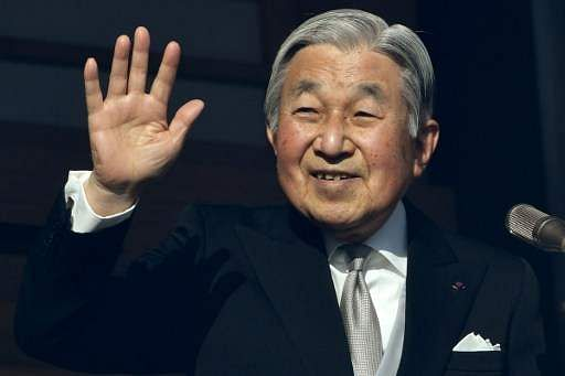 Japan's Emperor Akihito waving to well-wishers during his new year speech in Tokyo on January 2