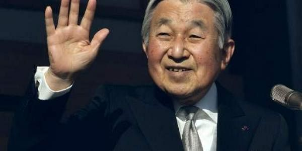 Japan's Emperor Akihito waving to well-wishers during his new year speech in Tokyo on January 2. (Photo   AFP)