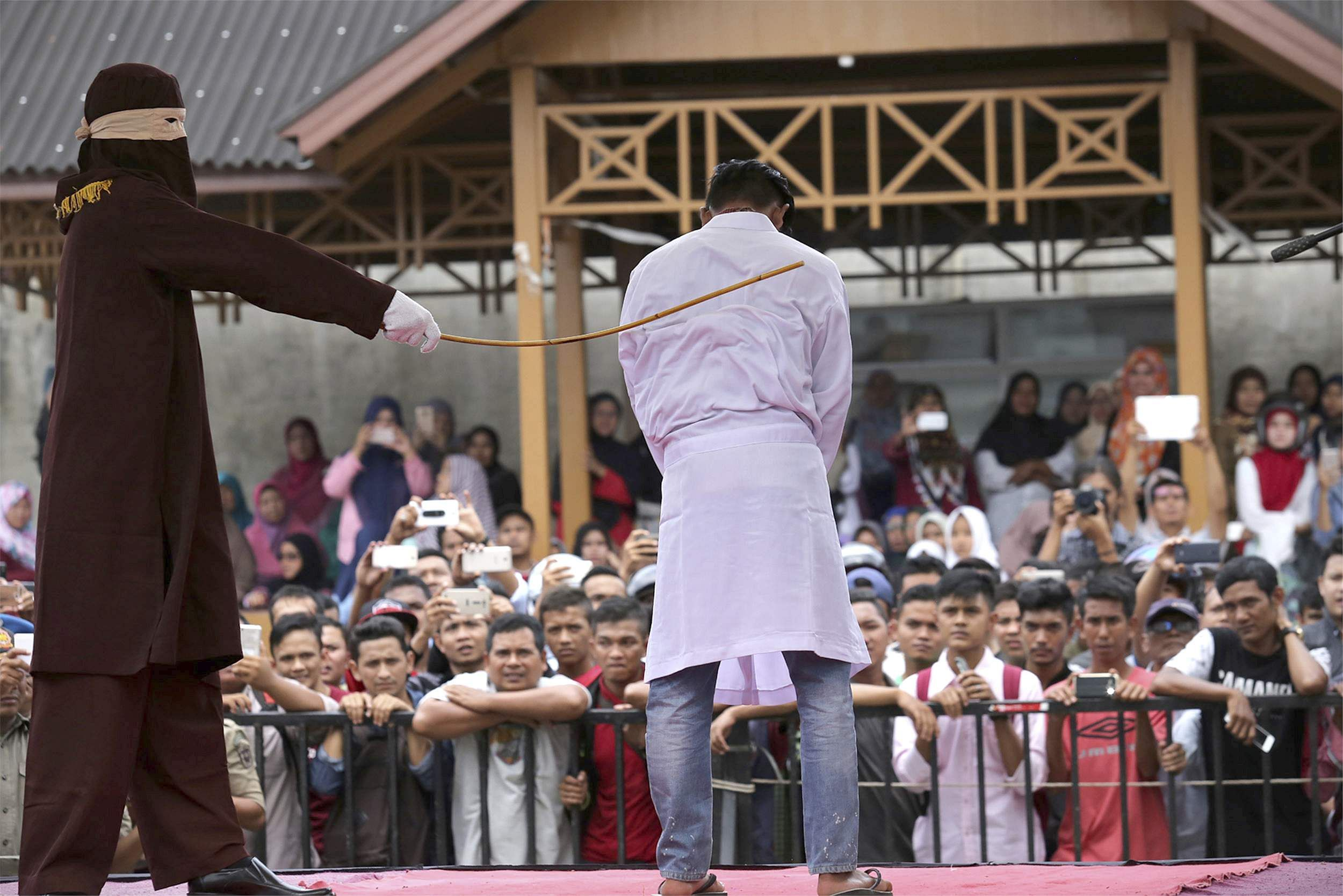 2 men in Indonesia caned dozens of times for gay sex- The ...