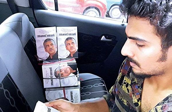 A youth sells the service story of former Vigilance director Jacob Thomas  'Sravukalkoppam Neenthumbol' from a car near the Press Club at Thiruvananthapuram on Monday | kaviyoor santhosh