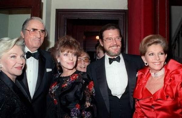 (From L to R) Line Renaud, Gregory Peck, Joan Collins, Roger Moore and his wife Kristina Moore arrive at the Palais Garnier Gala fund raising benefit for breast cancer research on April 25, 1989 in Paris. | AFP