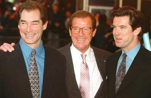 In this Sunday, Nov. 17, 1996 file photo, three of the actors who played James Bond, Timothy Dalton (left), Roger Moore (centre), and Pierce Brosnan, are at a London cinema to celebrate the life of Albert R 'Cubby' Broccoli, the American film producer behind seventeen Bond movies. In total, six actors have portrayed Bond officially. | AP