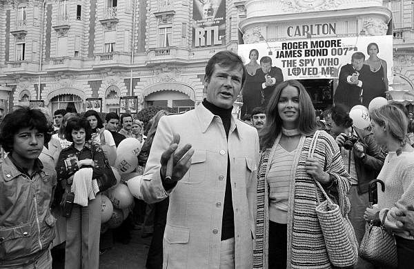 On May 20, 1977, Roger Moore is accompanied by co-star Barbara Bach as they arrive for the screening of their latest 007 feature, 'The Spy Who Loved Me,' during the Cannes Film Festival at the French Riviera. Moore died on May 23 in Switzerland after battling cancer, his family said. (File Photo | AP)