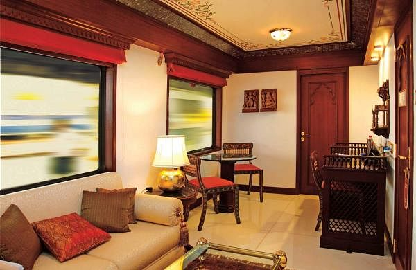 The tastefully furnished living area of the Presidential suite on the Maharajas Express. The journey is meant to be an opulent experience, and like a five-star hotel, a butler is at hand to cater to the affluent passengers, and comforts and services expected of a high-end hotel are provided on the train.
