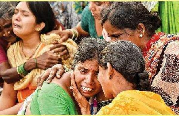Naresh's mother and sister mourn at the field where the remains were found at Lingarajupalli village in Yadadri district on Saturday   vinay madapu
