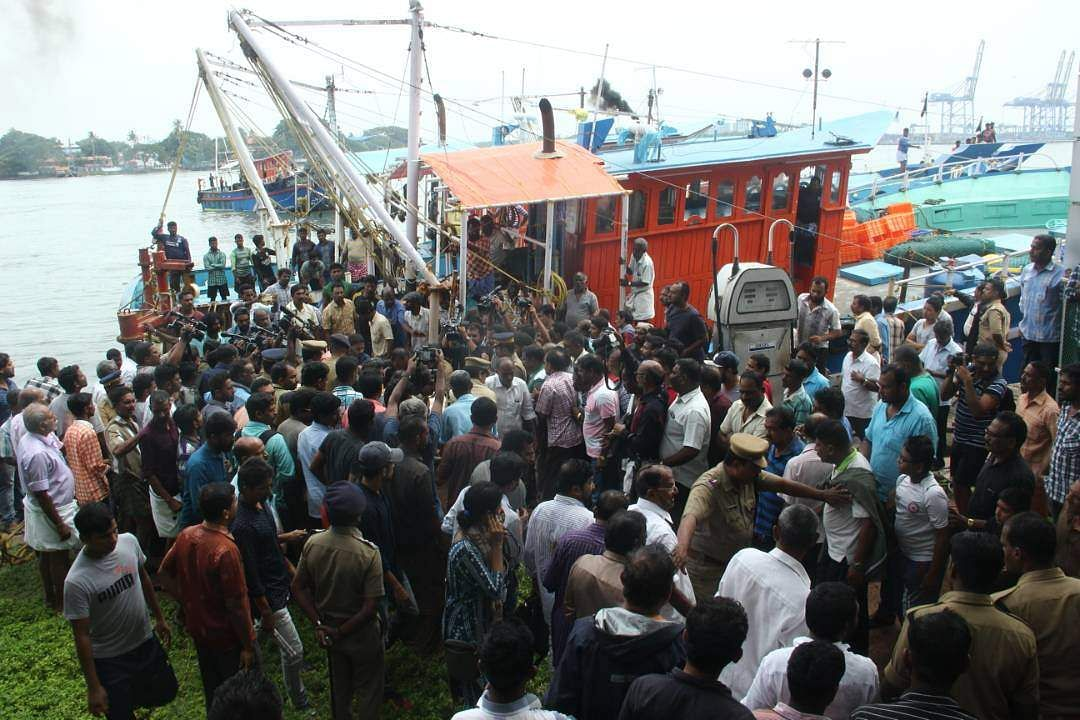 A boat arrives at Fort Kochi with the body of a fisherman who died when Amber L, a Panama-based cargo ship, collided with a fishing boat early on Sunday, June 11, 2017.