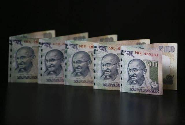 Rupee slips to 64.45 against dollar in opening trade