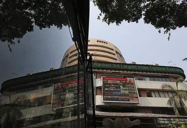 Sensex flat with negative bias; Nifty below 9600-level