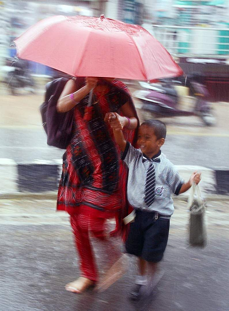 Going to school during Heavy rain at Sangareddy district, Telangana.