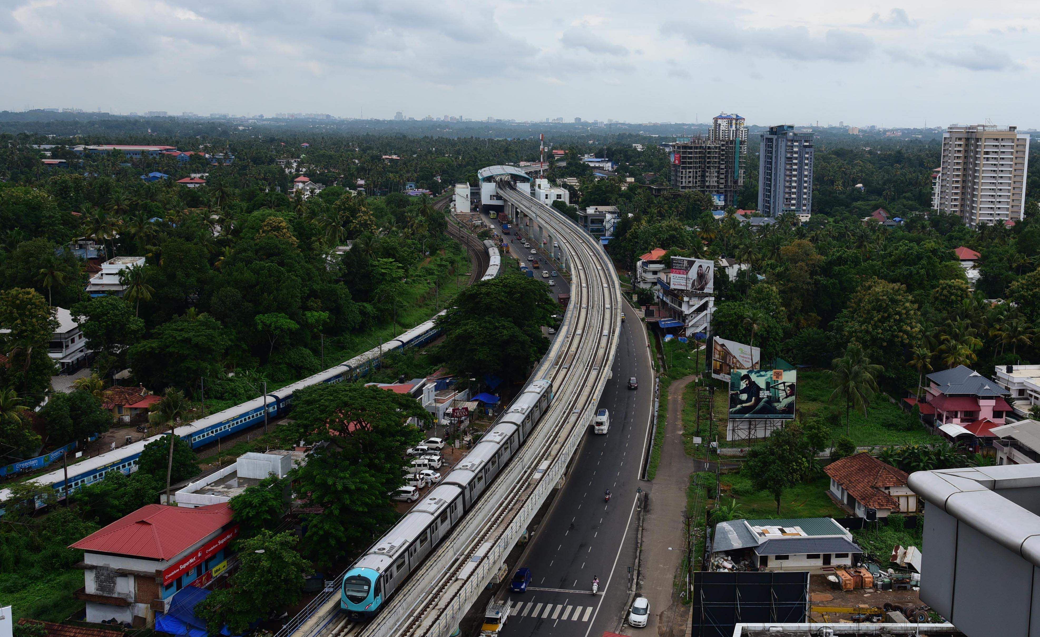 The 13-km metro is the eighth in India to be made operational. Here the metro can be seen running alongside a long-distance train in the background in Kochi. Kochi Metro is claimed to be the country's first integrated multi-model transport system. It is expected to improve regional connectivity and ease the traffic congestion in Kochi, the commercial hub of Kerala. (Albin Mathew | EPS)