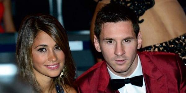 Barcelona's Argentine forward Lionel Messi (R) and his partner Antonella Roccuzzo. | AFP