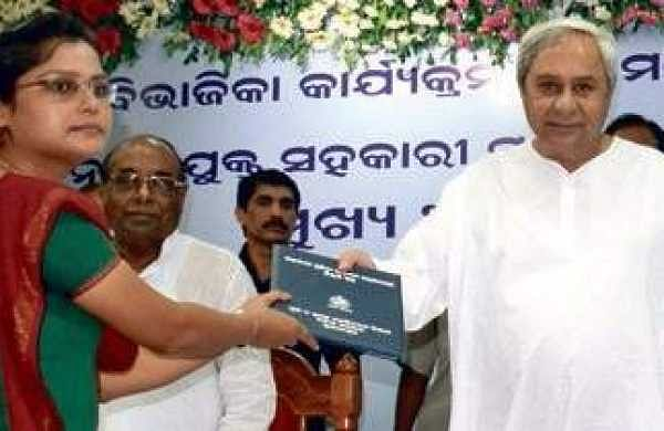 Chief Minister Naveen Patnaik handing over appointment letter to a newly recruited ASCO