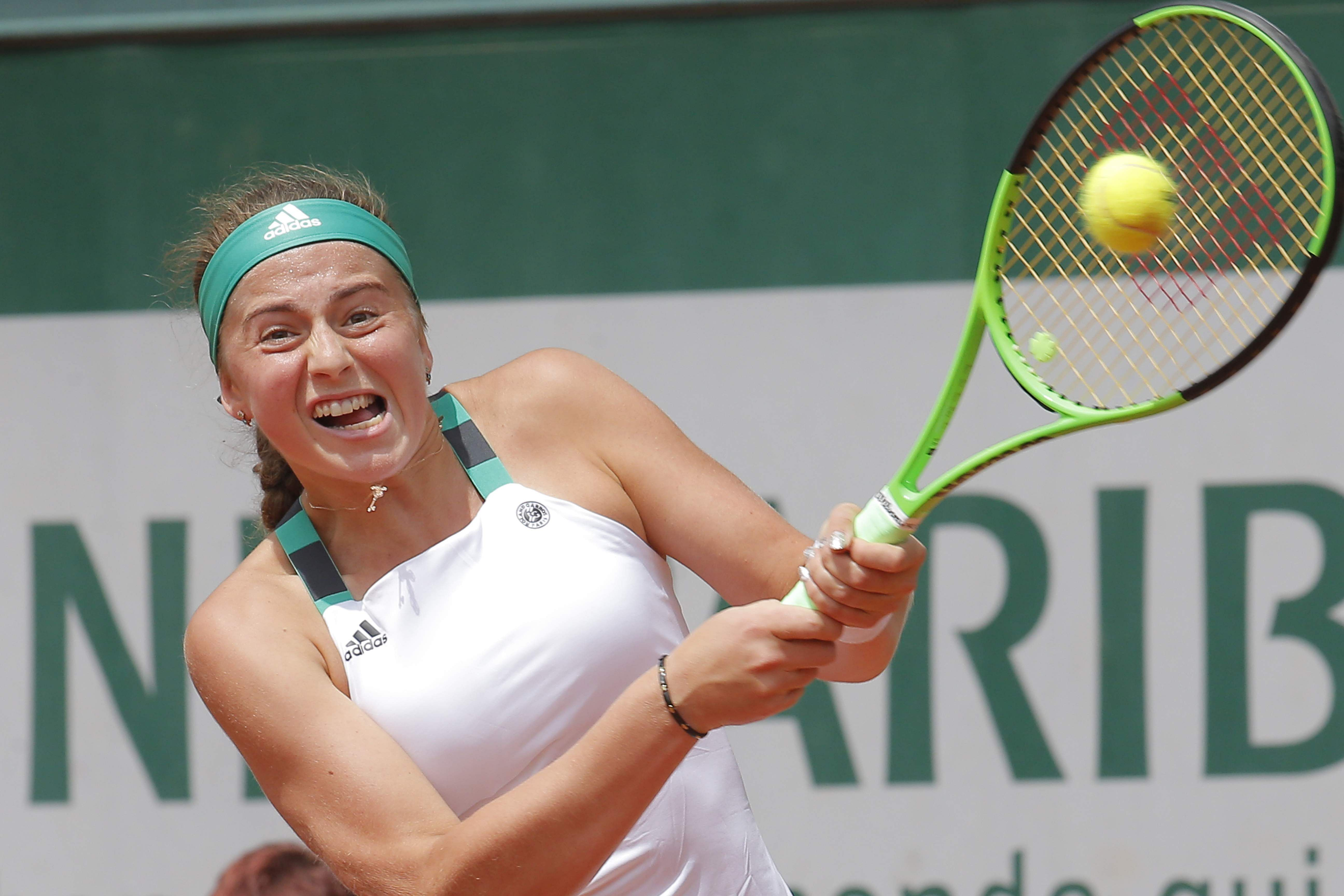 Ostapenko overpowers Stosur to reach first French Open quarterfinal