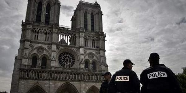 File pic: French soldiers stand guard in front of the Notre-Dame Cathedral in Paris on April 14, 2017, as worshippers and tourist arrive at the cathedral on Good Friday, the start of the Christian Easter celebrations.