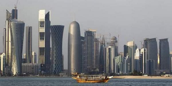 In this Thursday Jan. 6, 2011 file photo, a traditional dhow floats in the Corniche Bay of Doha, Qatar, with tall buildings of the financial district in the background. Qatar, now facing a diplomatic crisis with other Arab nations, is a small country with