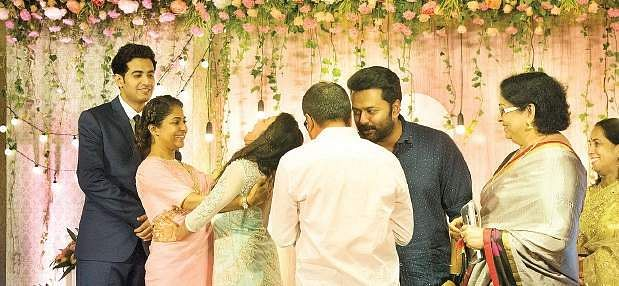Poornima Indrajith Sharing A Tender Moment With Kavya As V K Prakash And Mallika Sukumaran Looks On